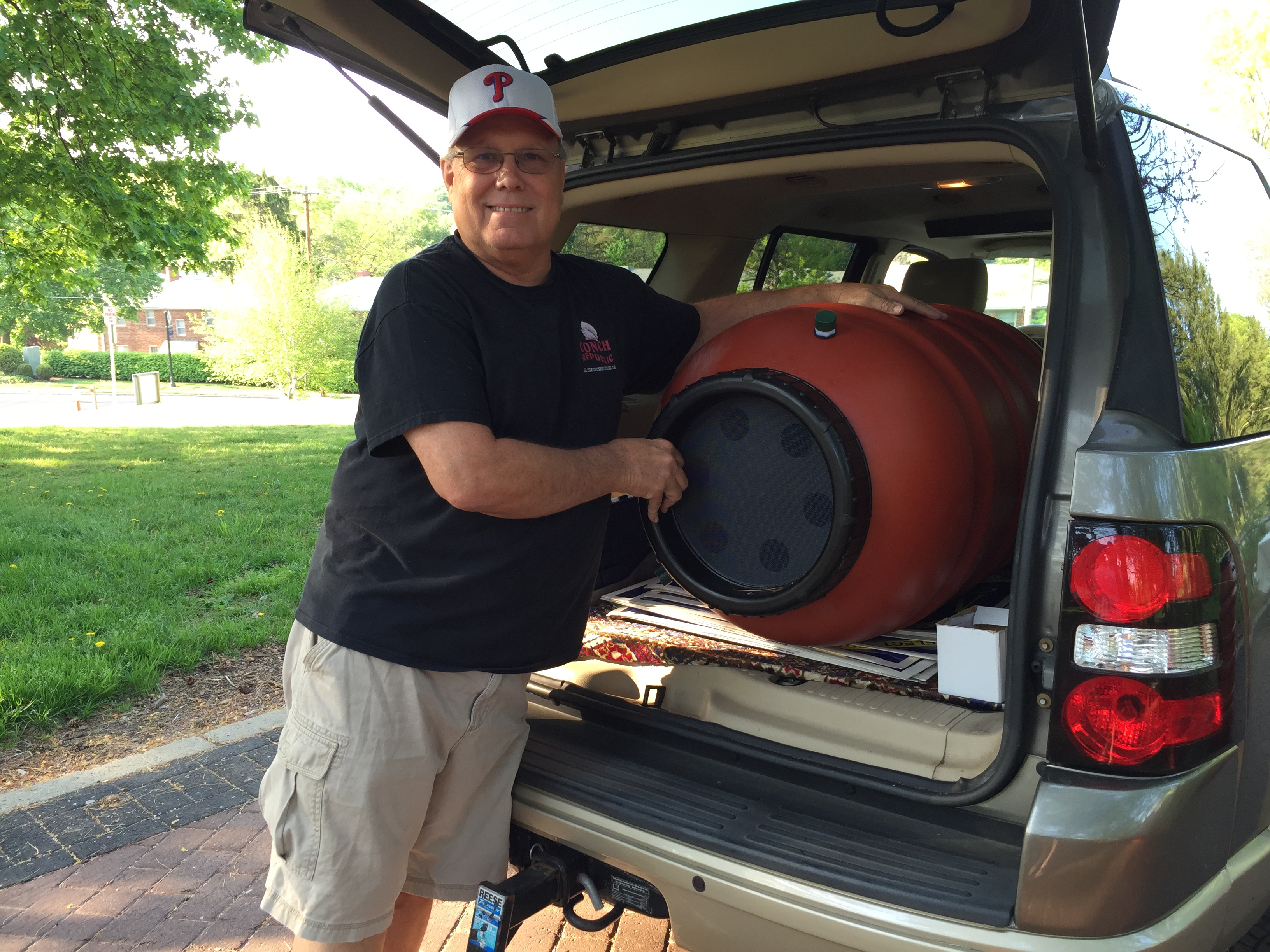 Commmissioner McKeown picks up his rain barrel.