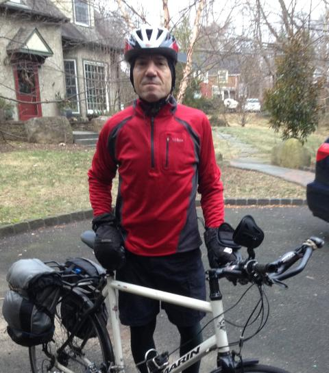 Johnathan DeHart poses with his bicycle.
