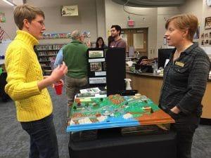 Karen from Briar Bush Nature Center talks with a workshop attendee.
