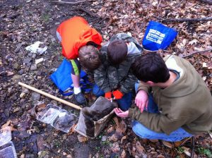 Streamkeeper Nick Macelko shows kids some of the bugs that live and grow in Baeder Creek.