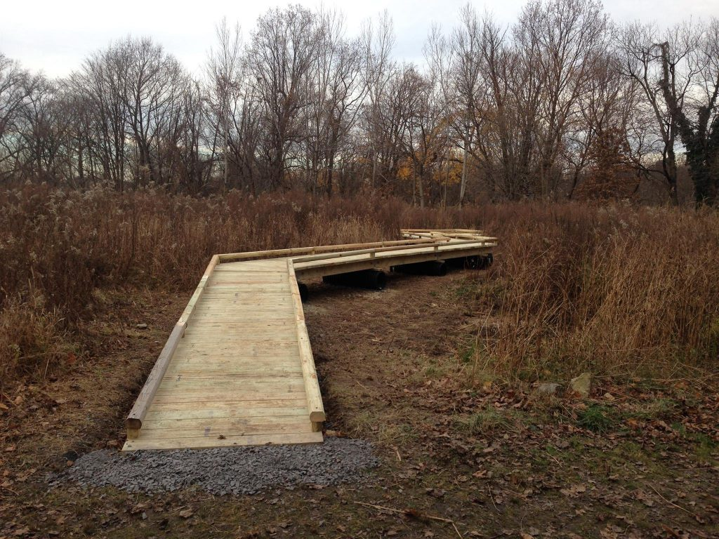 A wooden-plank walkway installed in High School Park, which is ADA-compliant.
