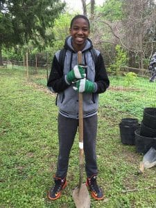 KJ with a shovel helping out at the Rock Lane buffer cleanup