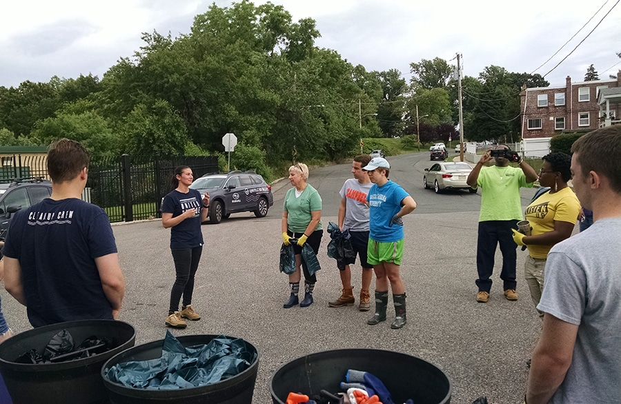 People gather for the United By Blue cleanup of Tacony Creek Park