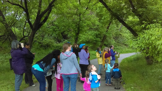Attendees look for birds in Tacony Creek Park.