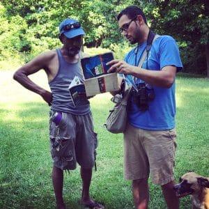 2 men looking at Bird Guide